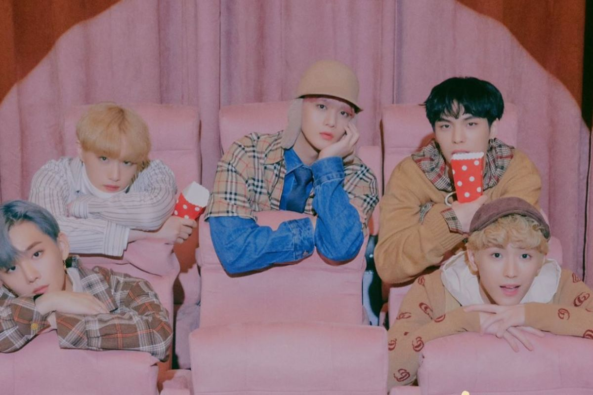 Teaser image of CIX sitting in a cinema for their new album (Hello Chapter Ø. Hello, Strange Dream) and the title track, Cinema.